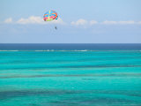 Para Sailing over Cable Beach, New Providence Island, Bahamas Photographic Print by Walter Bibikow