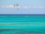Para Sailing over Cable Beach, New Providence Island, Bahamas Photographic Print by Walter Bibikow