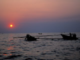 Silhouetted Boats on Lake Tanganyika, Tanzania Photographic Print by Kristin Mosher