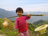 Young Girl Carrying Shoulder Pole with Straw Hats, China Lámina fotográfica por Keren Su