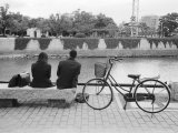 Couple by the Kyobashigawa River, Hiroshima, Japan Photographic Print by Walter Bibikow