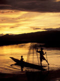 Intha Fisherman Rowing Boat With Legs at Sunset, Myanmar Photographic Print by Keren Su