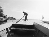 Boatman on Tonle Sap Lake, Cambodia Photographic Print by Walter Bibikow