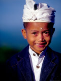 Boy in Formal Dress at Hindu Temple Ceremony, Indonesia Papier Photo par John & Lisa Merrill