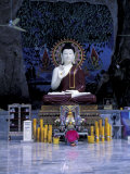 Monk Praying Near Buddha Statue, Thailand Photographic Print by John & Lisa Merrill