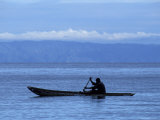 Canoe on Lake Tanganyika, Tanzania Photographic Print by Kristin Mosher