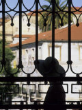 Tourist Gazes at Historic House through Iron Grillwork of Church, Lisbon, Portugal Photographie par John & Lisa Merrill