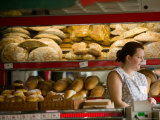 Woman in Bakery, Trogir, Croatia Photographic Print by Russell Young