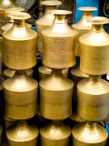 Stack of Brass Milk Jugs in Durbar Square, Kathmandu, Nepal Photographic Print by Bill Bachmann