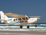Plane, Seventy Five Mile Beach, Fraser Island, Queensland, Australia Photographic Print by David Wall
