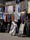 Street Vendor Displaying Fine Silk and Cotton for Sale, Edfu, Egypt Photographic Print by Cindy Miller Hopkins