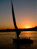 Felucca Silhouetted Against Setting Sun over the Nile at Luxor, Egypt Photographic Print by Cindy Miller Hopkins
