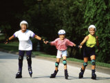 Generations of Women Rollerblading Together Photographic Print by Bill Bachmann