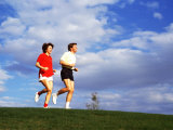 Middle-Aged Couple Jogging Together Photographic Print by Bill Bachmann