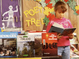 Girl in 3rd Grade Reading a Book about Europe Photographic Print by Bill Bachmann