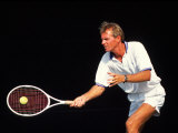 Close-up of Man Playing Tennis Photographic Print by Bill Bachmann