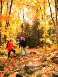 Young Family with Baby Hiking in Autumn Photographic Print by Bill Bachmann