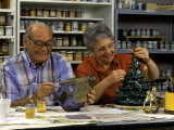 Retired Couple Making Ceramics in Art Class Photographic Print by Bill Bachmann