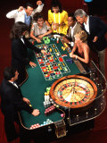 Mixed Ethnic Couples Enjoying Themselves in a Casino Photographic Print by Bill Bachmann