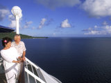 Retired Couple Enjoying the View on a Cruise Ship Photographie par Bill Bachmann