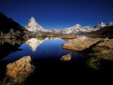 Matterhorn Reflected in Riffelsee, Zermatt, Switzerland Photographic Print by Art Wolfe