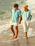 Middle-aged Couple Walking on the Beach Photographic Print by Bill Bachmann