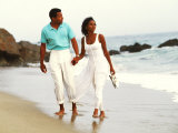 Black Couple Walking Together on the Beach Photographic Print by Bill Bachmann