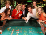 Couples Enjoying Themselves in a Casino Photographic Print by Bill Bachmann