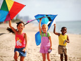 Children Flying Kites on the Beach Photographic Print by Bill Bachmann