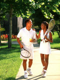 African American Couple Walking Together after Tennis Match Photographic Print by Bill Bachmann