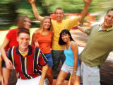 Teens Having Fun Outdoors Photographic Print by Bill Bachmann