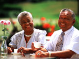 Retired African-American Couple Eating Together at Outdoor Cafe Photographie par Bill Bachmann