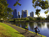 Cyclists, Yarra River and CBD, Melbourne, Victoria, Australia Photographic Print by David Wall