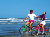 Middle-aged Couple Riding Bikes on the Beach Photographic Print by Bill Bachmann