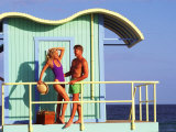Young Couple Relaxing at Lifeguard Stand on the Beach Photographic Print by Bill Bachmann