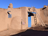 Pueblo House with Blue Door and Oven, Taos, New Mexico, USA Photographic Print by Charles Sleicher