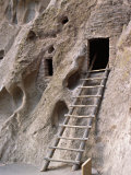 Ancient Anasazi Ruins and Cliff Dwellings in Rock, Bandlelier National Monument, New Mexico, USA Photographic Print by Charles Sleicher