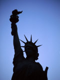 Silhouette of Statue of Liberty, New York City, New York, USA Photographic Print by Bill Bachmann