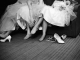 Teenage Girls Resting Feet at First Formal Dance at the Naval Armory Lámina fotográfica por Cornell Capa