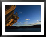 A Cyclist Atop a Rock Overhang Near Dolores, Colorado Posters by Bill Hatcher