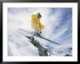 A skier in a yellow suit goes airborne Print by Paul Chesley