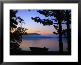 Silhouette of a motor boat on the shores of a bay in Alaska Prints by Joel Sartore
