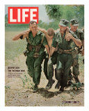 Wounded US Marine Helped to Safety by his Buddies During Fight with Viet Cong, July 2, 1965 Premium Photographic Print by Bill Eppridge
