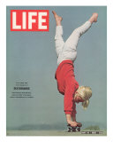 Girl Doing Handstand on Skateboard, May 14, 1965 Photographic Print by Bill Eppridge