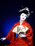 Close-up of Geisha Girl in Blue with Fan, Kyoto, Japan Photographic Print by Bill Bachmann