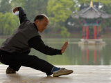 Man Doing Tai Chi Exercises at Black Dragon Pool with One-Cent Pavilion, Lijiang, China Photographic Print by Pete Oxford