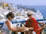 Women Having Coffee on Cafe Terrace, Santorini, Greece Photographic Print by Bill Bachmann