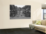 Bicycle Leaning Against a Metal Railing on a Bridge, Amsterdam, Netherlands Wall Mural