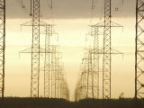 Line of High Tension Industrial Electrical Towers at Dusk Photographic Print