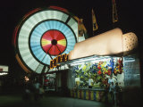 Motion Blur of Spinning Carnival Ride at Night Photographic Print